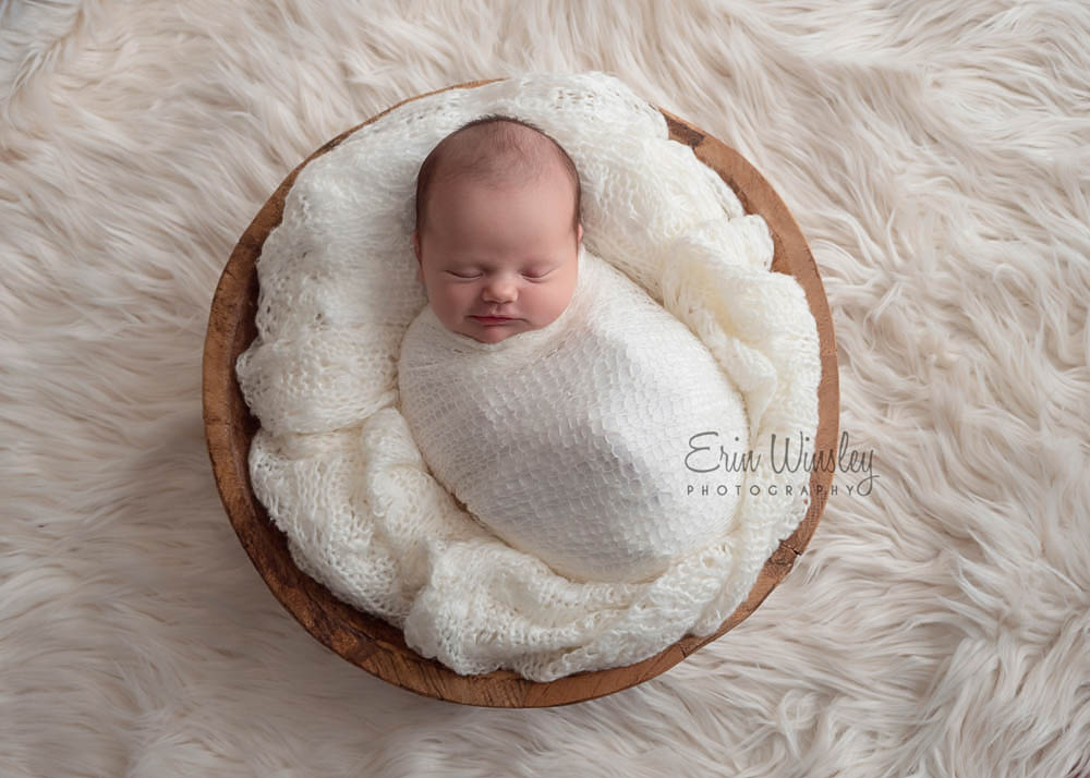 Newborn-Baby-wrapped-in-white-newborn-photography